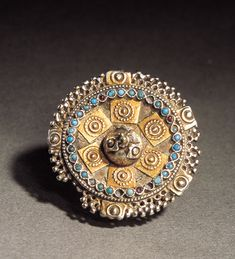 Ring from Pakistan 								Pakistan  Gold, silver, turquoise Late 19th century  Diameter 5cm