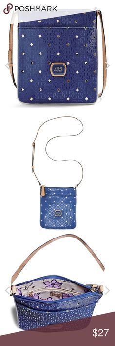 Guess Blue cream gold Crossbody bag side purse zip Guess Blue cream gold Crossbody bag side purse  Has blue pen or market ink on the inside, see pictures for condition, royal blue color Guess Bags Crossbody Bags