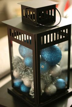 No one will believe me, but I LITERALLY just did this as a centerpiece for my… Blue Christmas Decor, Christmas Lanterns, Christmas Table Decorations, Silver Christmas, Christmas Balls, Christmas Home, Christmas Holidays, Christmas Wreaths, Christmas Crafts