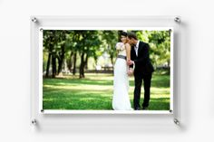 """Floating acrylic frame fits multiple images up to 11""""x17"""" or 12""""x18"""" (great for construction paper)."""