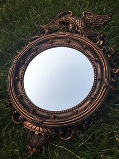 A personal favorite from my Etsy shop https://www.etsy.com/listing/400029115/vintage-nautical-porthole-eagle-convex