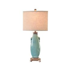 Teal blue is the trending color this season. Accent a room with a teal table lamp for a pop of color!