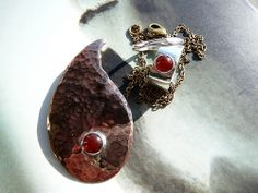 Sterling silver ring and bronze paisley pendant
