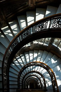 The wonderfully designed semi-circular staircase at the Rookery Building, a historic landmark located in the Loop community area of Chicago in Cook County, Illinois, United States.  © Marian Kraus Photography