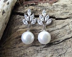 These pearl drop earrings have a simple crystal leaf style Swarovski crystal feature to the top and a lovely round white or ivory pearl feature beneath. Wedding Earrings Drop, Bridal Earrings, Bridal Jewelry, Black Pearl Earrings, Leaf Earrings, Pearl Jewelry, Jewelery, Blind, Rustic Wedding Jewelry