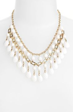 Free shipping and returns on Cara Statement Necklace at Nordstrom.com. White beads create cool contrast on a dramatic gold-plated necklace that beautifully drapes the collar.