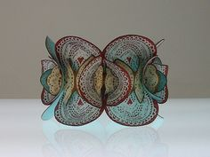 Bracelet by Ulrike Hamm. Parchment (treated animal skin), dyes.