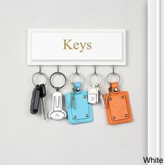 @Overstock.com - Hanging Key Holder - Keep your keys and on-the-go items neatly organized with this darling hanging key holder. Crafted of MDH wood in a smooth finish with five (5) display hooks and 'Keys' engraved in the center, this wall mountable display is ideal for posting by entryways.  http://www.overstock.com/Home-Garden/Hanging-Key-Holder/8438585/product.html?CID=214117 $34.99