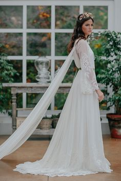 Wedding Dress Ideas, Designers & Inspiration : El Revel wedding dress from Oh Luna 2016 Collection – Long sleeve wedding dress with sheer cape detail – see the rest of the collectio… Boho Gown, Bohemian Wedding Dresses, Designer Wedding Dresses, Bridal Gowns, Wedding Gowns, Bridal Jumpsuit, Wedding Hair Inspiration, Wedding Ideas, Wedding Cape