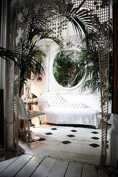 Love the macrame curtain in the doorway