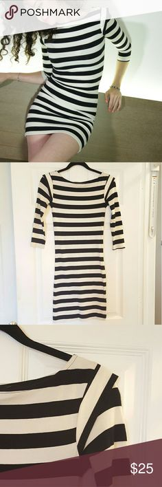 French Connection Dress Black and white striped, body hugging, mini dress with elbow length sleeves and cap sleeve detail at the shoulder. Very soft, pleasant to touch and stretchy Jersey fabric. 94% cotton 6% elastine/spandex. French Connection Dresses Mini