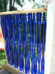 Wine Bottle Privacy Wall - cover the AC unit?Wine Bottle Privacy Wall Really cool until it gets hit by hail!Wine Bottle Privacy Wall - No instructions, but should be pretty easy to figure it out!Privacy Wall with Wine Bottles, Corks, Copper, Walnut & Wine Bottle Fence, Wine Bottle Design, Wine Bottle Corks, Wine Bottle Crafts, Bottle Art, Wine Bottle Trees, Blue Bottle, Recycled Glass Bottles, Old Bottles