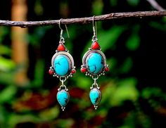 Hey, I found this really awesome Etsy listing at https://www.etsy.com/listing/237383365/sterling-silver-turquoise-and-red-dangle