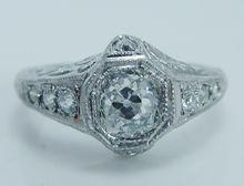 Vintage Old European cut Diamonds .87ct center Filigree Ring Platinum