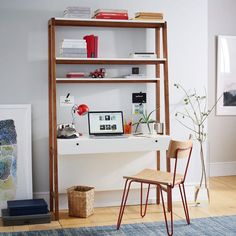 Inspired by Scandinavian modernism, our Modern Wall Desk pairs a sleek body with a pecan-finished frame and beautifully angled legs. Its wide desktop offers plenty of workspace while drawers and shelves help keep everything organised.