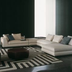 L-shaped sofas - love the geometric rug