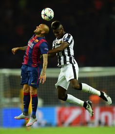 Daniel Alves of Barcelona and Paul Pogba of Juventus jump for the ball during the UEFA Champions League Final between Juventus and FC Barcelona at Olympiastadion on June 2015 in Berlin, Germany. Barcelona Futbol Club, Fc Barcelona, Paul Labile Pogba, Daniel Alves, Professional Football, Uefa Champions League, Berlin Germany, Entrepreneurship, Finals