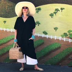 Midi dress, wide leg pants, flats and statement accessories | Photo by Tamera Beardsley (@tamerabeardsley) | For more style inspiration visit 40plusstyle.com