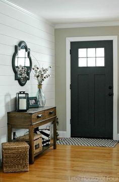Black door and shiplap in the entryway, Fixer Upper style | 100+ Beautiful Mudrooms and Entryways at http://Remodelaholic.com