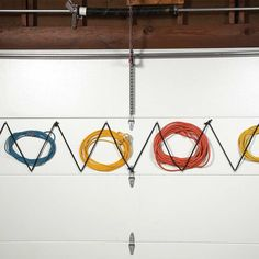 "Garage doors are a perfect place to store lightweight items like extension cords. (they stay put when the door opens and closes.) Install screw eyes diagonally about 8"" apart and thread bungee cords (with ends cut off) through them. A perfect bungee ""corral"" to hold extra extension cords 