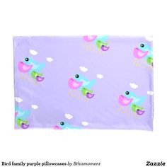Pastel purple pillowcase with a happy and colorful bird family decorating it. Lovely.