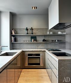 The stone gives visual texture to this neutral kitchen.   japanesetrash.com