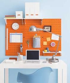 I learned today that Home Depot (and others) sells painted metal pegboards in this and other great colors (like yellow)...which can also be used as a magnet board. I'm so excited!