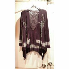 Plum Cardigan This plum colored cardigan with beautiful gems, crochet back, and super soft material will look great with jeans, maxi skirt or dress pants. A great piece to complete an outfit to go out for date night or a night out with the girls. I have only worn it once. Doral Tops Tunics