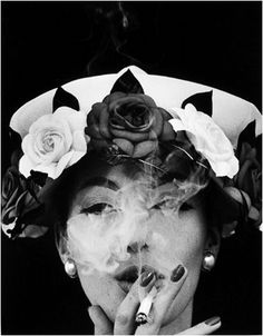 Hat + 5 Roses, Paris Vogue, 1956. Photographed by William Klein. Give me that hat, lady. Give me.