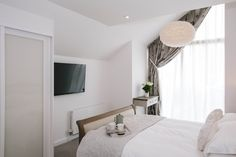 The master bedroom at 1 The Sands, a self-catering holiday cottage in Polzeath, North Cornwall. The bedroom is light and airy with a modern en-suite. North Cornwall, Private Garden, New Builds, Sands, Catering, Master Bedroom, Cottage, Holiday, Modern