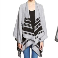 "BP Horizontal Stripe Poncho Throw this lightweight woven poncho over your favorite outfit for extra warmth during the cooler seasons! 23"" front length; 27"" back length. No closure. 100% acrylic. bp Sweaters Shrugs & Ponchos"