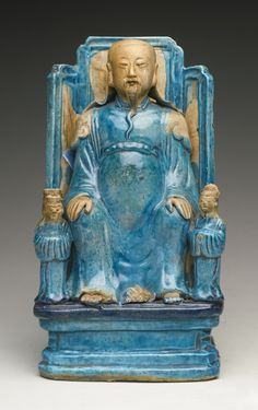 A TURQUOISE-GLAZED ZHENWU AND ATTENDANTS GROUP QING DYNASTY, KANGXI PERIOD Height 10 1/8  in