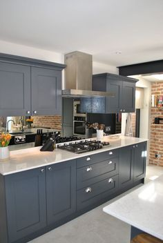 Modern shaker kitchen in dark slate blue looks stunning against the brick wall. The cabinets are complemented by marble effect quartz worktop. Modern Shaker Kitchen, Shaker Style Kitchen Cabinets, Modern Grey Kitchen, Grey Kitchen Designs, Shaker Style Kitchens, Kitchen Cabinet Styles, New Kitchen, Kitchen Decor, Blue Kitchen Ideas