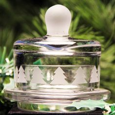 A craft punch, contact vinyl  and Armour Glass Etching Cream was used for this winter tree design that dressed up a plain and ordinary little butter dish into a seasonal treasure.          Project instructions:http://www.etchtalk.com/Item/Christmas_Tree_Butter_Dish        Supplies: www.etchworld.com