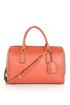 A structured bag goes from prim to pop in a bright color
