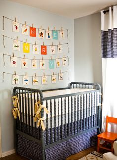 nursery crib with vintage alphabet flashcards hanging on twine with clothespins | Photo by Mandy Busby / MB Photo