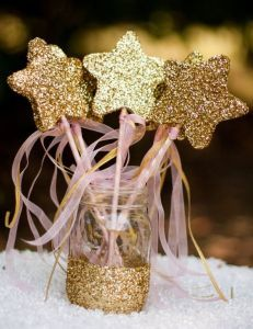 pink and gold twinkle star pops in mason jar