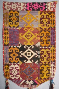 Uzbek Embroidered Hanging with Ikat Backing, Silk/Cotton, Late 19th/Early 20th Century, 13.5 x 8 not including tassels