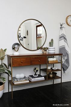 love this sideboard console and round mirror
