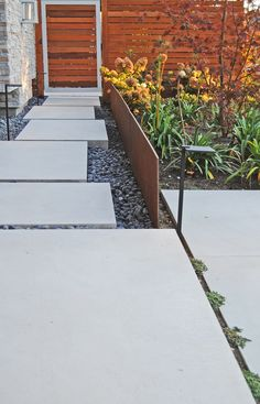Corten steel and large, elevated concrete stepping stones create a welcoming, modern pathway. Large Concrete Pavers, Concrete Backyard, Concrete Path, Modern Landscaping, Front Yard Landscaping, Front Walkway, Landscaping Ideas, Landscape Design, Garden Design