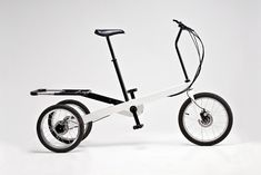 The Vienna Bike is an electrically assisted tricycle that rides with the feeling of a two-wheeler through its innovative steering and unique suspension system. This allows the bike to tilt easily to the right or left while riding it. Velo Design, Electric Tricycle, Pro Bike, Design Industrial, Folding Bicycle, Cool Tech, Super Bikes, Baby Strollers, Vienna