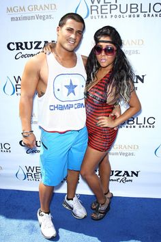 Snooki shows off her size four bod in a bathing suit