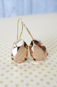 Swarovski crystal teardrops set on gold plated kidney wire earrings.  ✦ Swarovski Crystal Teardrop (18mm x 13mm) - Rose Gold (as shown in pictures)