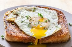 Ever had a Croque-Madame? This is a classic French ham and grilled cheese sandwich, topped with a fried egg! Great for an easy lunch or dinner. #CroqueMadame #FrenchFood #GrilledCheese #Sandwich #FriedEgg