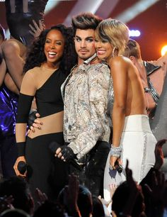 "Snapshot: December 17 - Kelly Rowland, Adam Lambert And Keri Hilson - A kiss for the host. Kelly Rowland laughs after Keri Hilson plants a kiss on ""VH1 Divas"" host Adam Lambert on Dec.16 in Los Angeles...2012"
