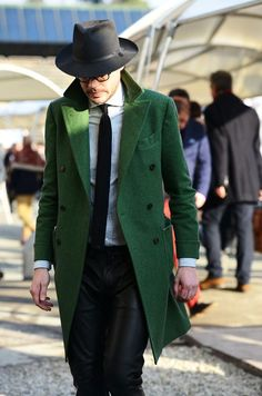 Pair a green overcoat with black leather track pants for an easy to wear, everyday look.  Shop this look for $884:  http://lookastic.com/men/looks/hat-tie-dress-shirt-overcoat-sweatpants/4212  — Black Hat  — Black Tie  — White and Navy Horizontal Striped Dress Shirt  — Green Overcoat  — Black Leather Sweatpants