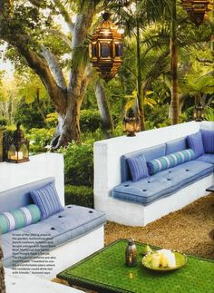 Moroccan inspired outdoor room by Helene Aumont built in seating with a low wall outdoors with low tables and lanterns lovely cushions such serene vibe Outdoor Seating, Outdoor Rooms, Outdoor Gardens, Outdoor Living, Outdoor Furniture Sets, Outdoor Decor, Outdoor Daybed, Moroccan Garden, Built In Seating
