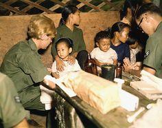 Second Lieutenant Kathleen M. Sullivan treats a Vietnamese child during Operation MED CAP, a U.S. Air Force civic... - NARA - 542331 - Vietnam War - Wikipedia, the free encyclopedia