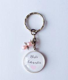 Handgemachter Cabochon Schlüsselanhänger Beste Schwester mit Schutzengel, perfekt als Geschenk zum Geburtstag, Weihnachten, Hochzeit. In liebevoller Handarbeit erzeugt, der Anhänger wird liebevoll...