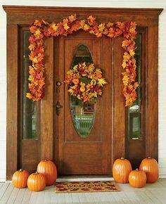 Easy Fall Decor for your door or entryway with premade autumn leaf wreath, garland, welcome mat and craft pumpkins
